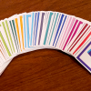 Privacy game cards fanned out to show size and color of deck.